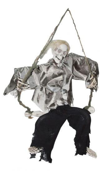 Lachendes Skelett auf der Schaukel