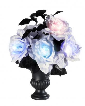 Blumenvase mit leuchtenden Kunstrosen
